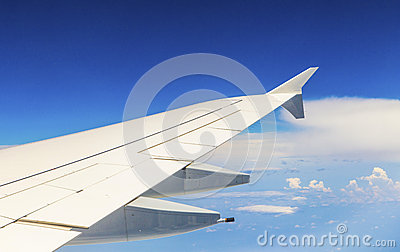 Wing of aircraft in the blue sky