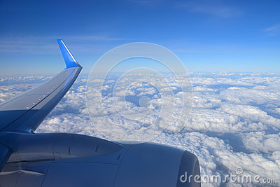 Wing aircraft over clouds