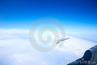 Wing in the blue sky with white clouds