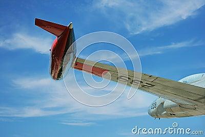 Wing of old jet in flight
