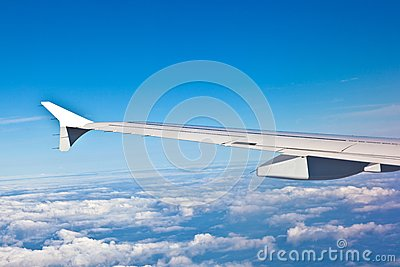 Wing of the plane with blue sky