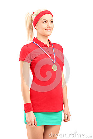 Winner female tennis player with a golden medal standing