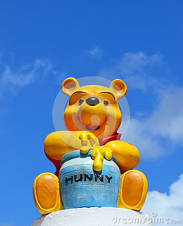 Winnie the pooh  Disney figure eating honey Editorial Image
