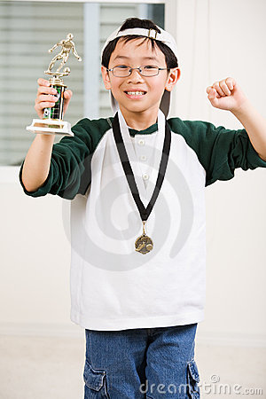 Winning boy with his medal and trophy