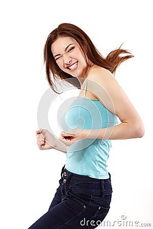 Winning teen girl happy ecstatic gesturing success