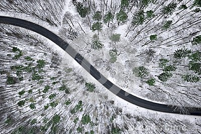 Winter aerial view of road in forest. Stock Photo