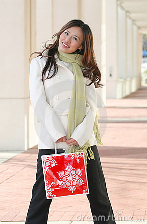 Winter: Asian Woman with Holiday Shopping Bag