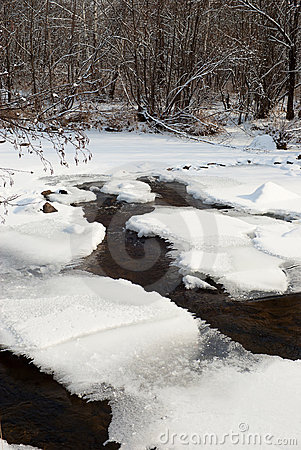 Winter background with a frozen river
