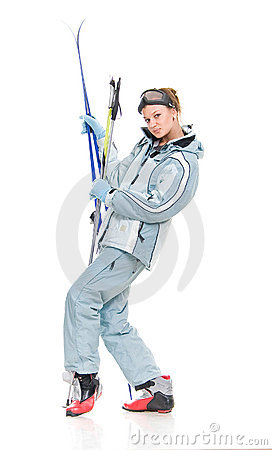 Winter beautiful girl in sports suit and with skis