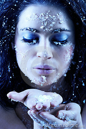 Winter beauty blowing snowflakes