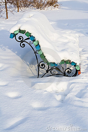 Winter bench covered with snow