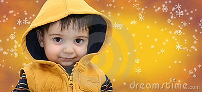 Winter Boy Child on Yellow Snowflake Background Stock Photo
