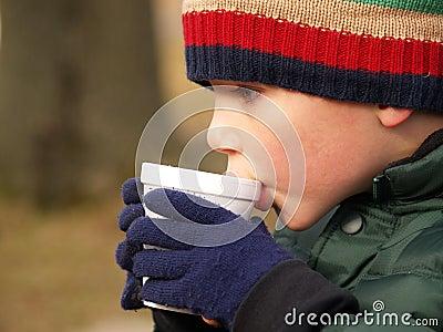 Winter boy drinking cocoa