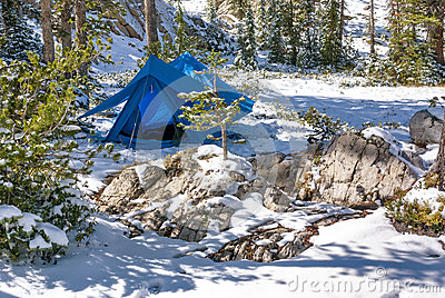 Winter camp with a tent in the snow