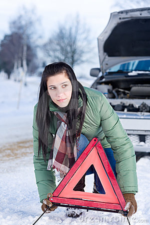 Winter car breakdown - woman warning triangle