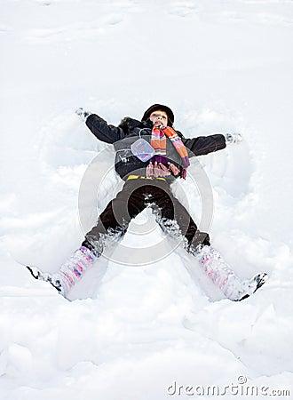 Winter child play lie in snow