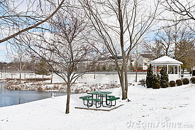 Winter city scene with a picnic table and gazebo