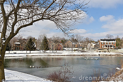 Winter city scene with a pond