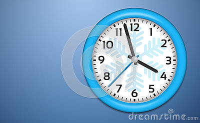 Winter Clocks on cold blue wall