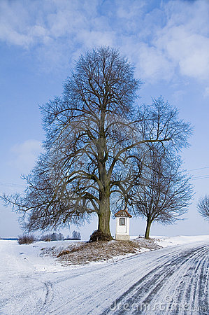 Free Winter Country Road With A Village Chappel Stock Photo - 10524530