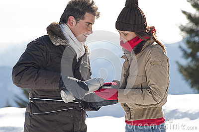 Winter couple with hot drinks