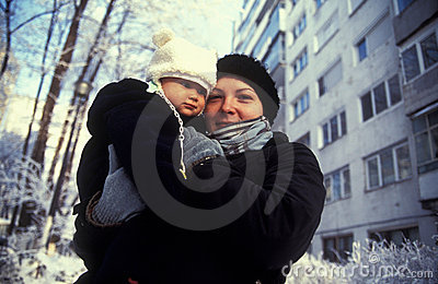 Winter dressed mother with child