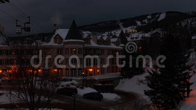 Winter evening getting dark at ski resort in mont Tremblant time lapse stock video footage