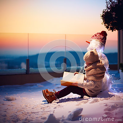 Free Winter Fairy Tale. Young Boy, Kid Reading Interesting Book To His Friend Snowman At The Backyard Royalty Free Stock Photography - 84317567
