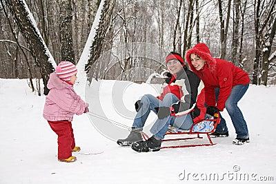 Winter family on sled