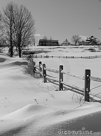 Winter: farm buildings in snow