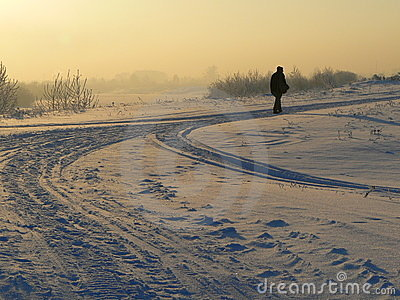 Winter field and walking man