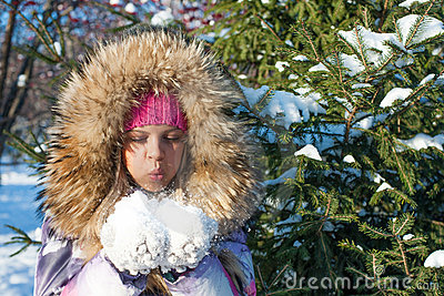 Winter girl blow on snow