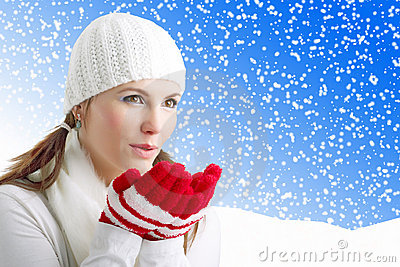 Winter Girl blowing snowflakes