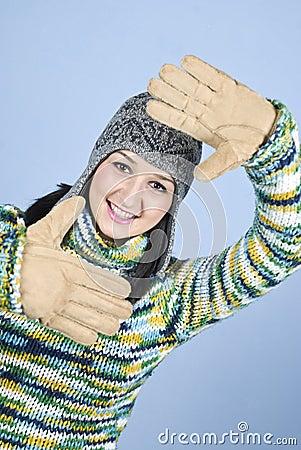 Winter girl framing face