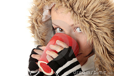 Winter girl with hot cup