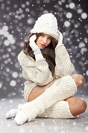 Winter girl with many snowflakes