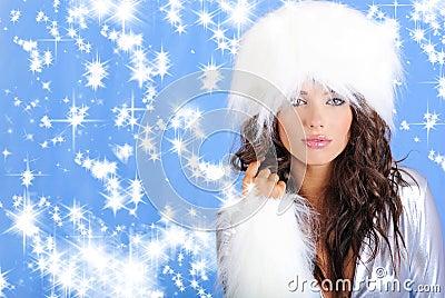 Winter girl wearing white fur hat