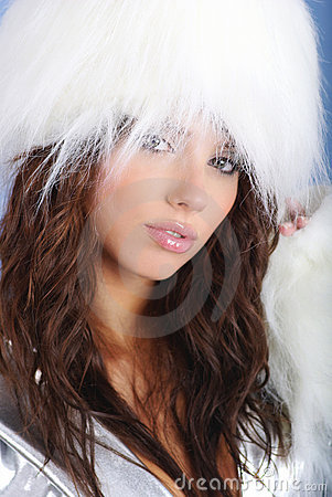 Winter girl wearing white fur hat