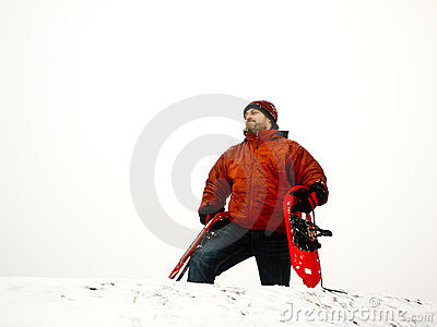 Winter Hiker - Man with snowshoes on snowy peak
