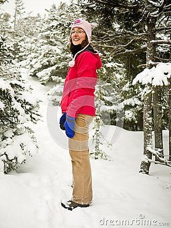 Winter Hiker - Woman on snowy hiking trail