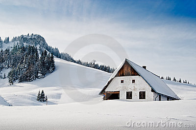 Winter idyllic with small hut