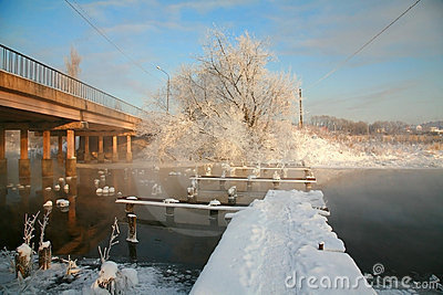 Winter landscape with the bridge