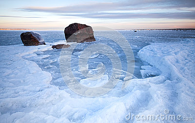 Ice and stones on frozen Baltic Sea