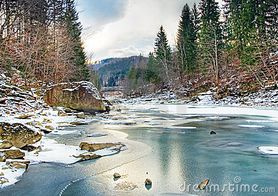 Winter landscape with mountain river