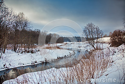Winter landscape with river