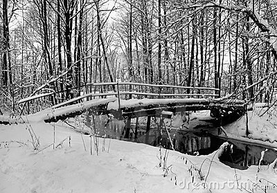 Winter landscape with small river and foot-path