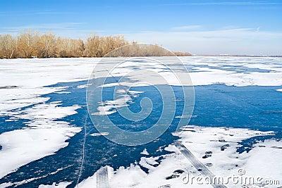 Winter landscape - track on a frozen river