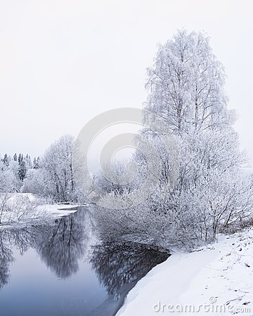 Free Winter Landscape With Frosty Trees And Peaceful River At Evening Stock Photography - 107906552
