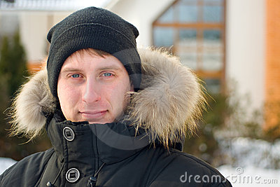 Winter - man in cap and warm jacket