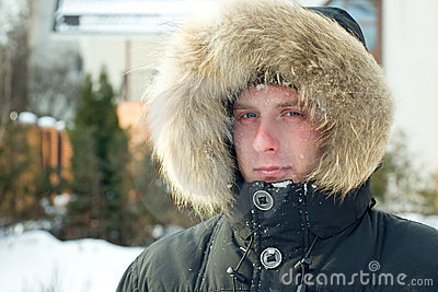 Winter - man in warm jacket with furry hood